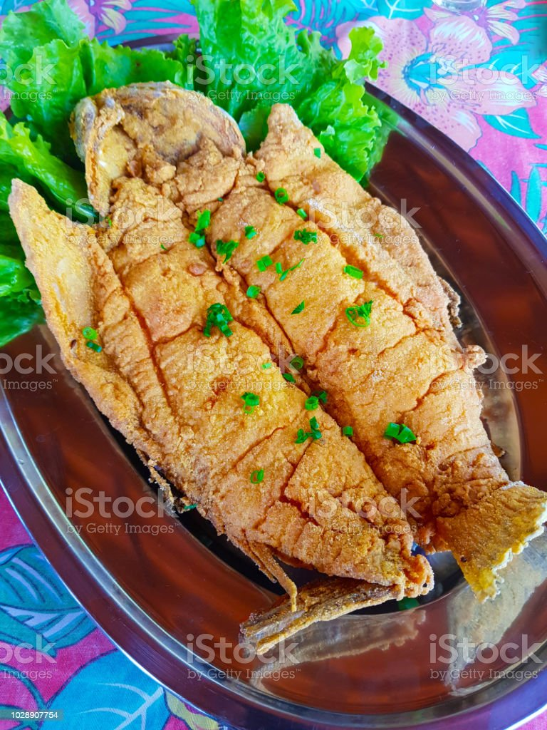 Fried Fish And Whole Breaded With Salad Of Lettuce Tomato