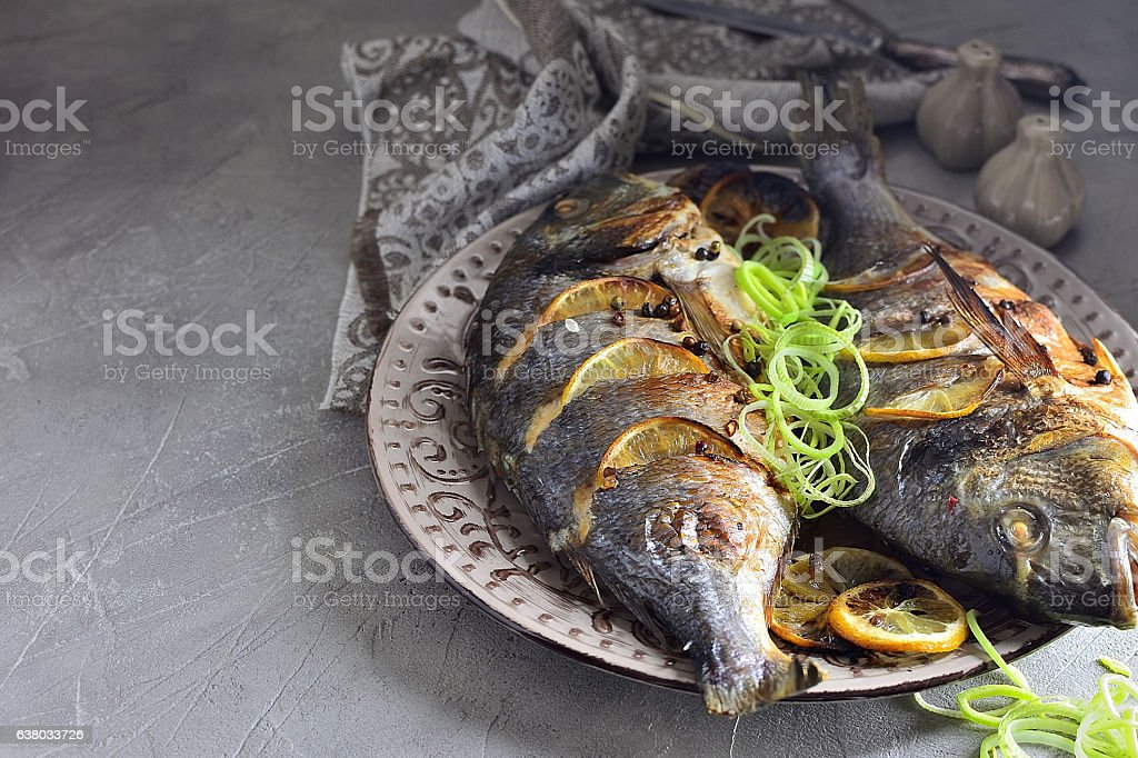 Fried fish dorado stock photo