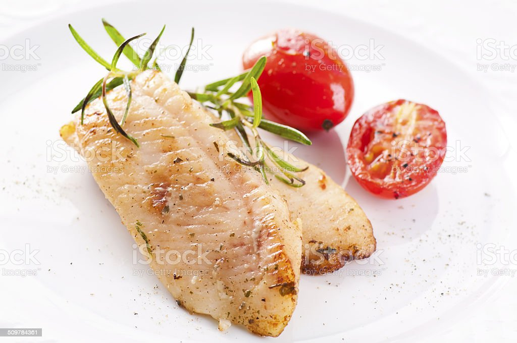Fried Fish Fillet with Tomatoes stock photo