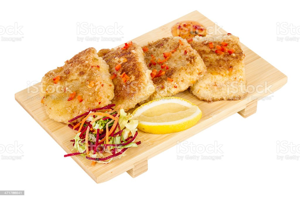 Fried fish fillets with  salad. royalty-free stock photo