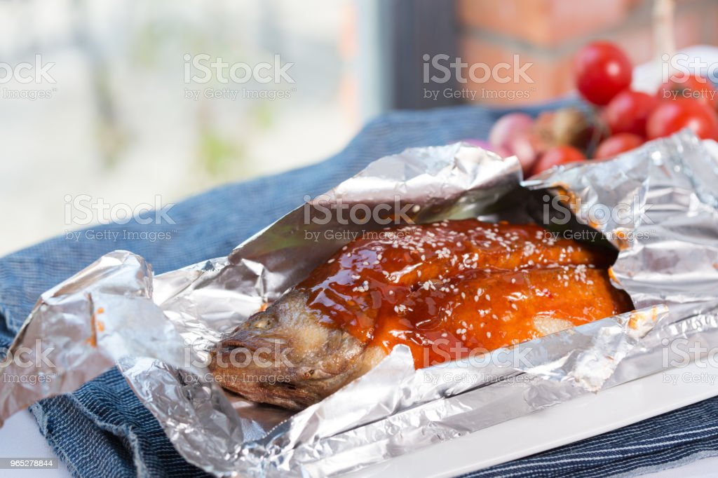 Fried fish in foil royalty-free stock photo