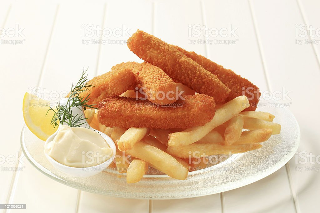 Fried fish sticks and French fries stock photo