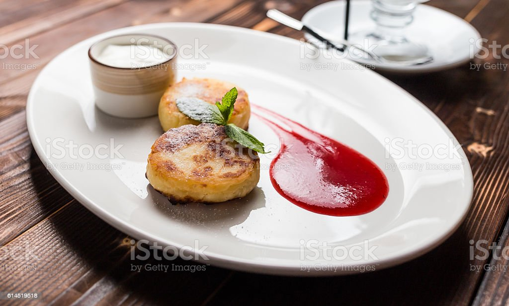 Fried fritters on plate stock photo