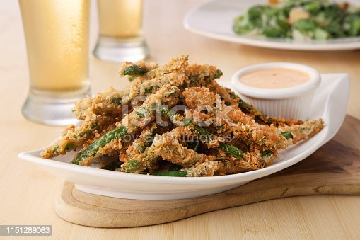 a plate of breaded and deep-fried green beans