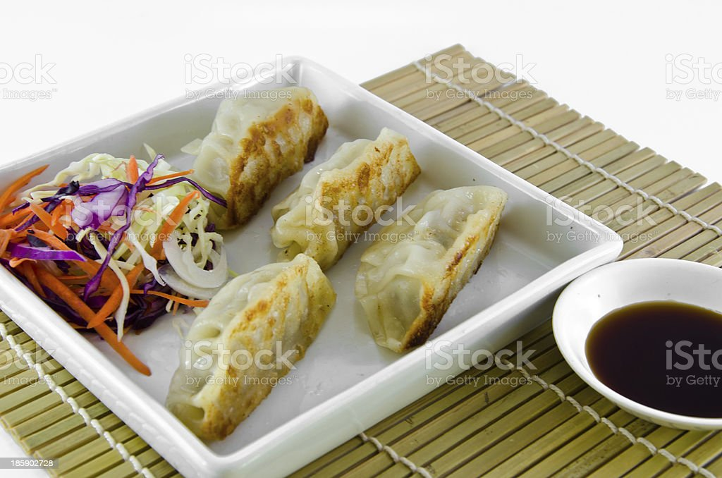Fried gyoza is cooked place on a plate stock photo