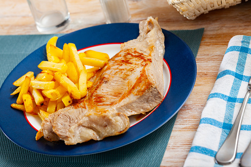 Fried Iberian pig served with potatoes