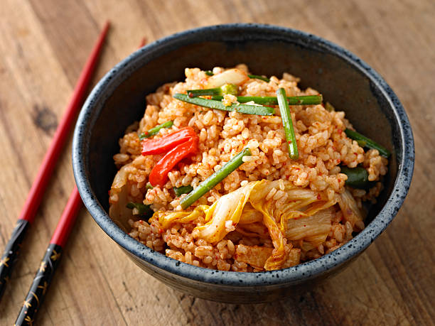 Fried Kimchi Rice Fried Brown Rice with Kimchi. fried rice stock pictures, royalty-free photos & images