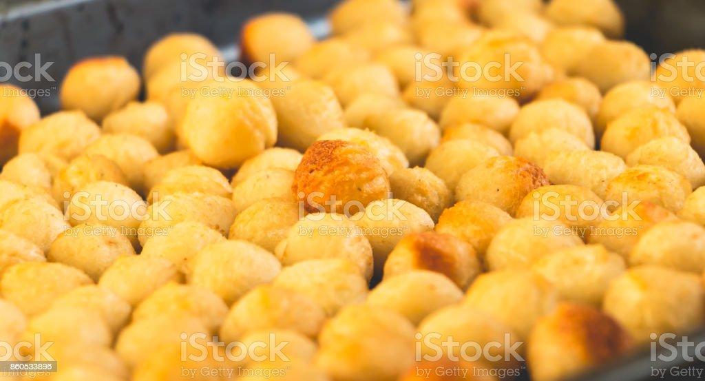 fried mashed potato balls in a frying pan stock photo