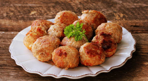 Fried meat ball, delicious meat cutlets on rustic dark table stock photo
