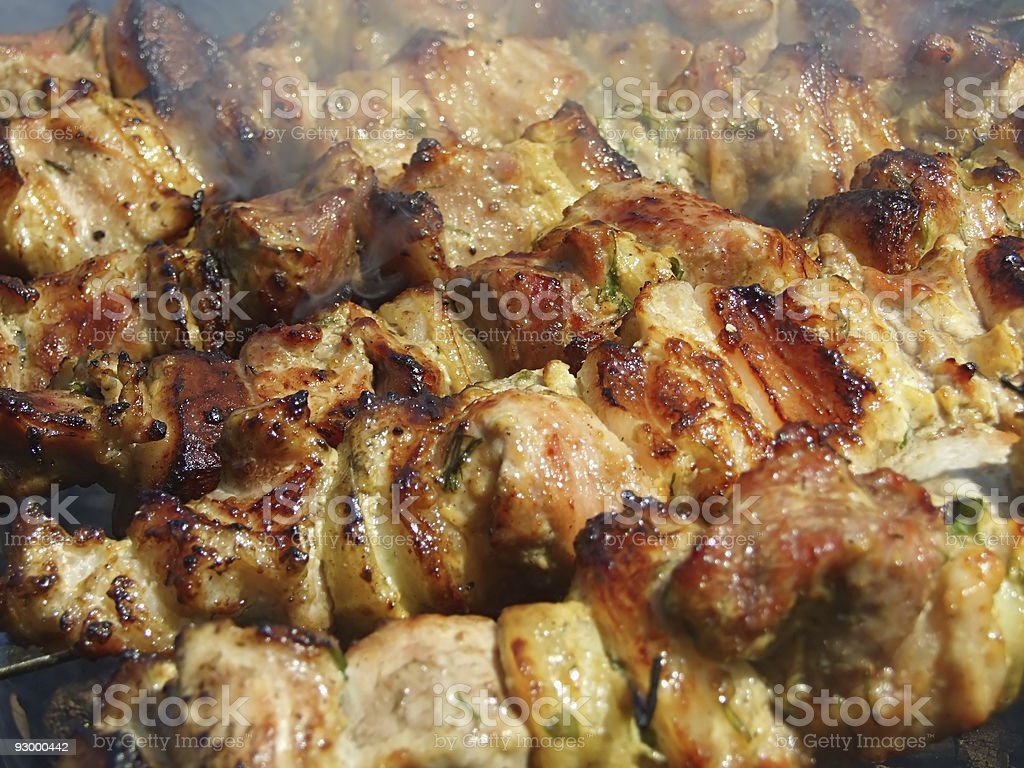 Fried meat on smoke royalty-free stock photo