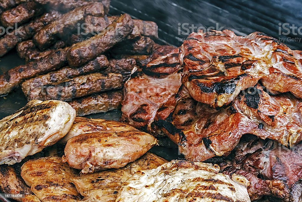 Fried meat placed on the grill royalty-free stock photo