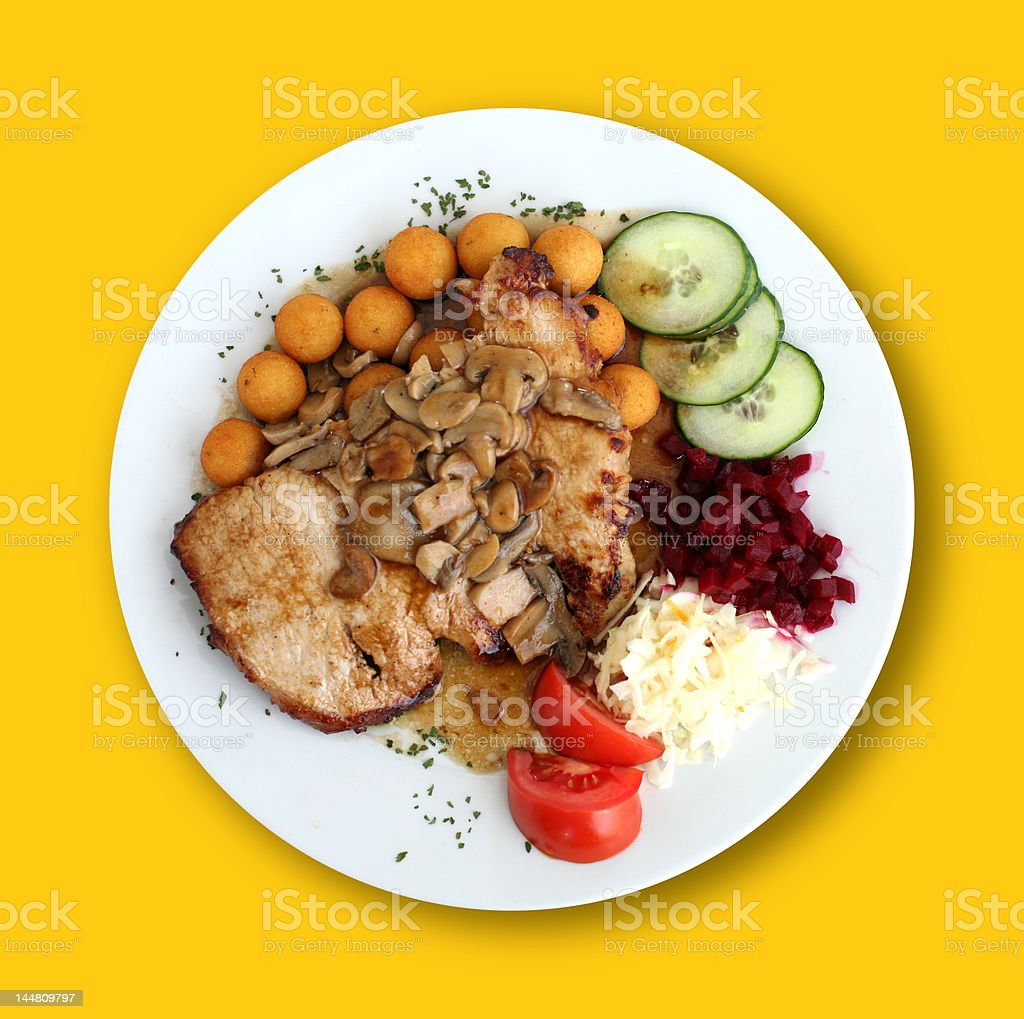 Fried Meat under Champions on the Yellow Table royalty-free stock photo