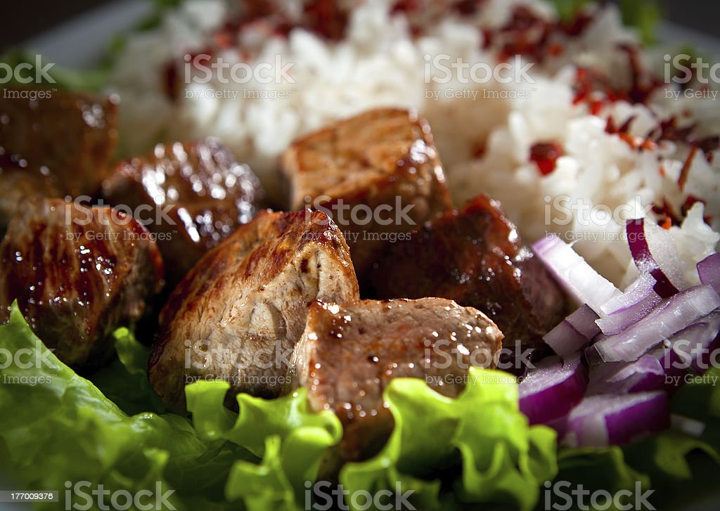 fried meat with rice and vegetables royalty-free stock photo
