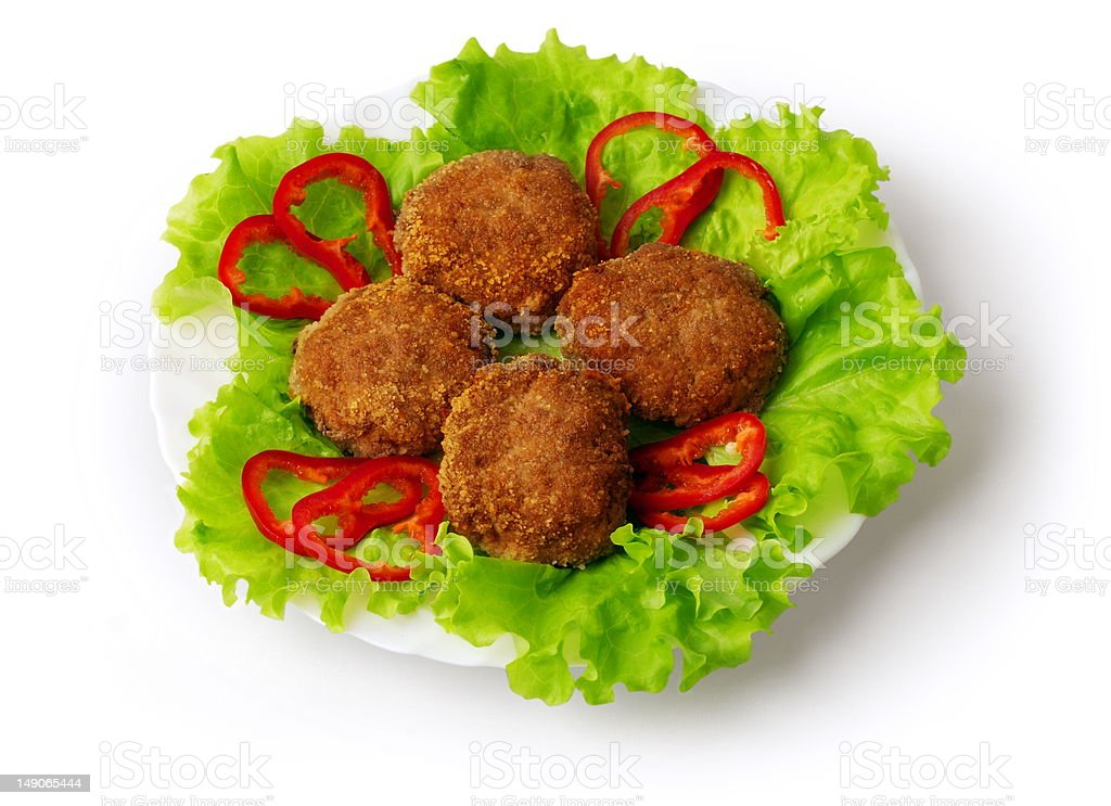 Fried meatballs decorated with pepper, salad and tomatoes royalty-free stock photo