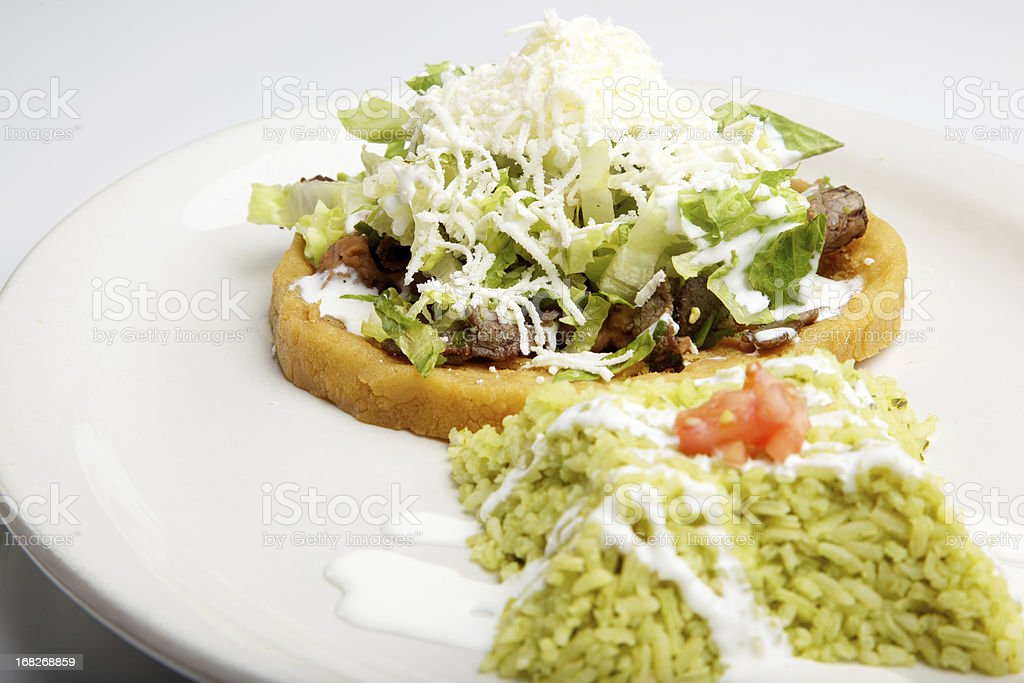 Fried Mexican Corn Dough topped with Refried Beans stock photo