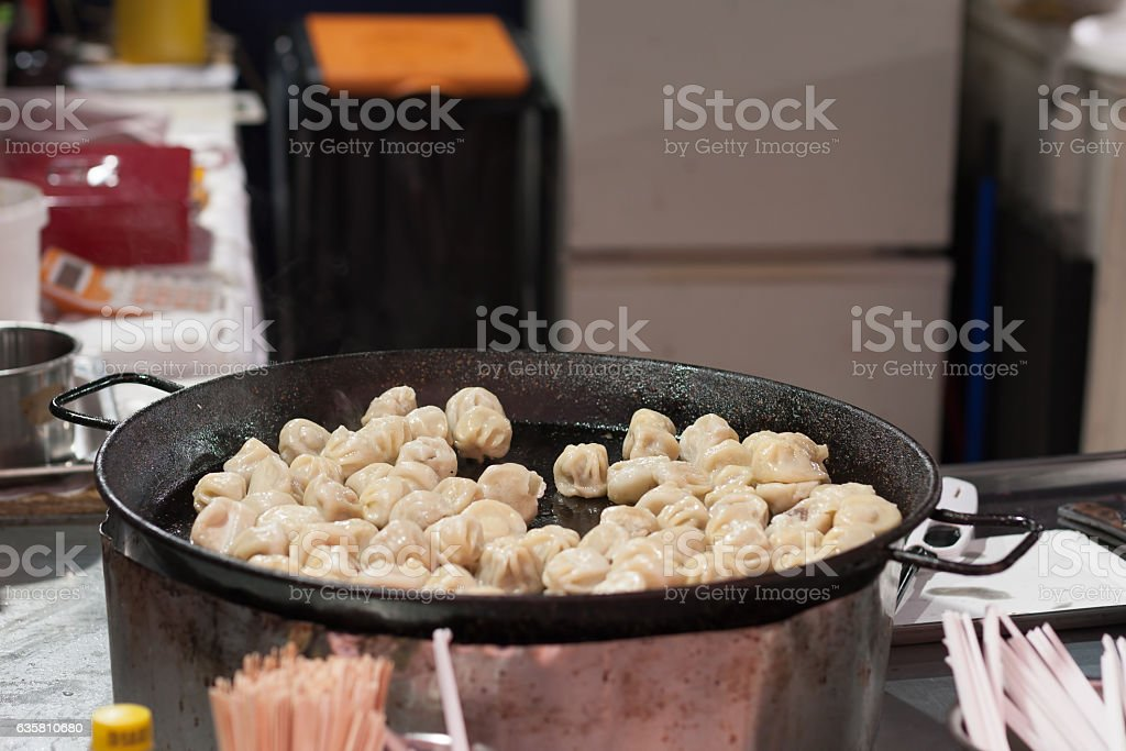 Fried Mongolian dumpling with meat at Christmas market stock photo