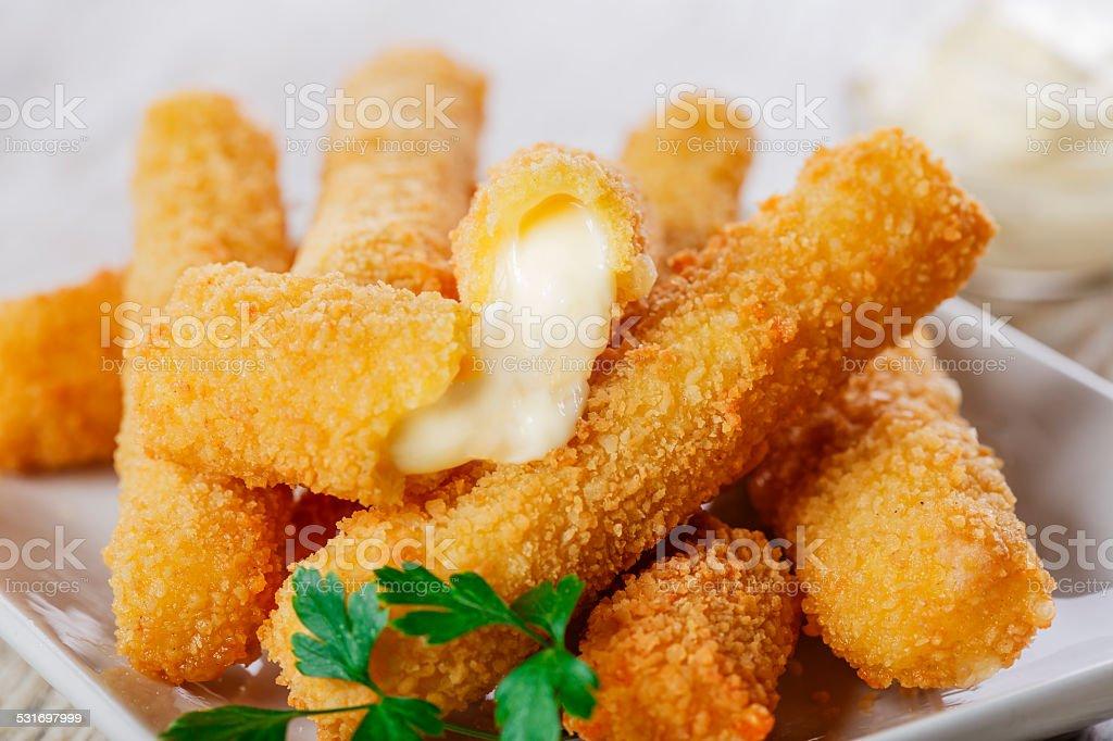 fried mozzarella cheese sticks breaded stock photo