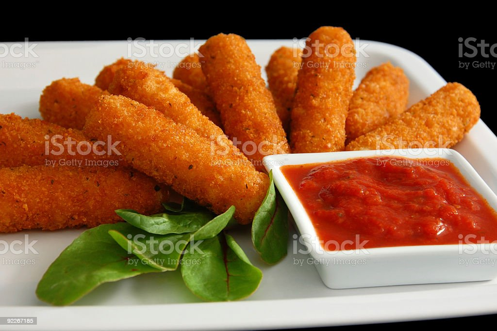Fried mozzarella sticks with sauce dip and green leaves stock photo