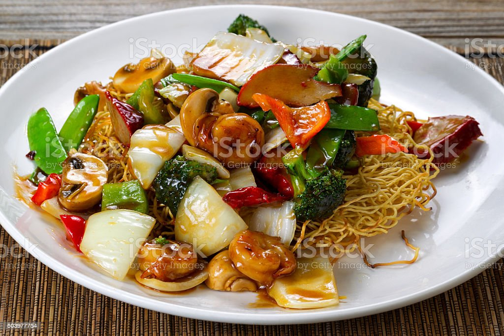 Fried noodle with shrimp and vegetables in sauce stock photo