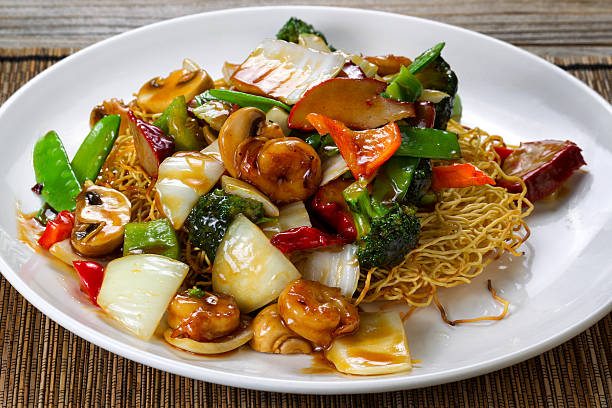 fried noodle with shrimp and vegetables in sauce - chinese food stock photos and pictures