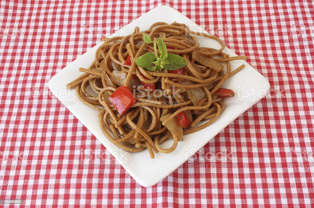Fried noodles with vegetables and basil royalty-free stock photo