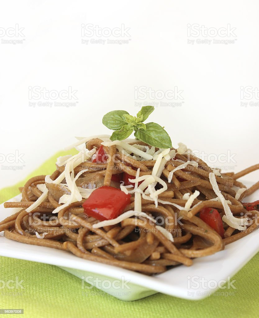 Fried noodles with vegetables, basil and cheese royalty-free stock photo