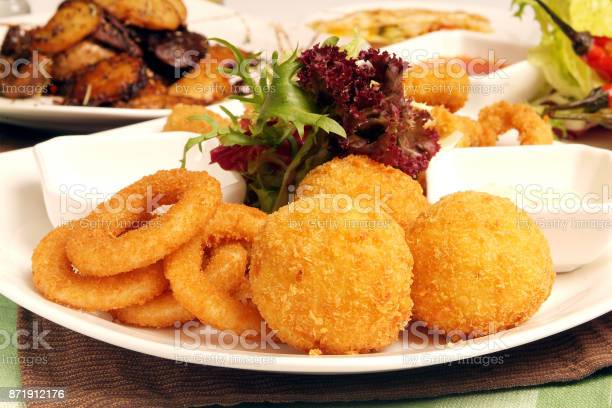 Fried onion rings, fried cheese balls and sauce platter