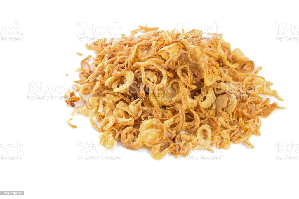 Fried onions or crispy fried onion flakes isolated on white stock photo