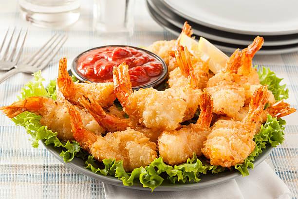 fried organic coconut shrimp - kızartılmış stok fotoğraflar ve resimler