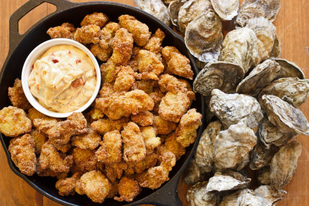fried oysters - oyster stock pictures, royalty-free photos & images