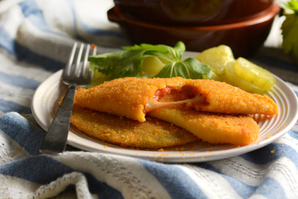 Fried panzerotti filled with tomato sauce and cheese -  Italian Food - closeup Fried panzerotti filled with tomato sauce and cheese -  Italian Food - closeup hot pockets stock pictures, royalty-free photos & images