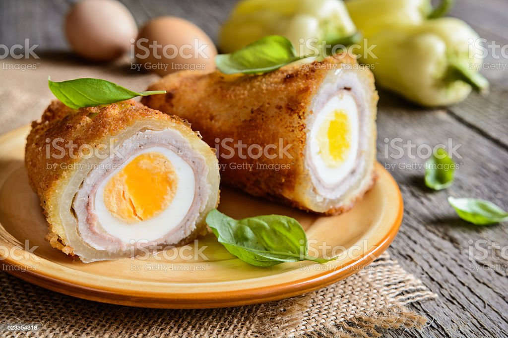 Fried pepper stuffed with pork cutlet, ham, cheese and egg stock photo