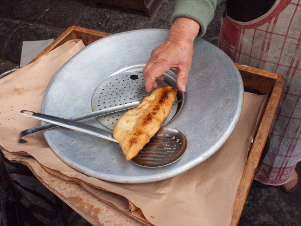 Fried pizza  in the street stock photo