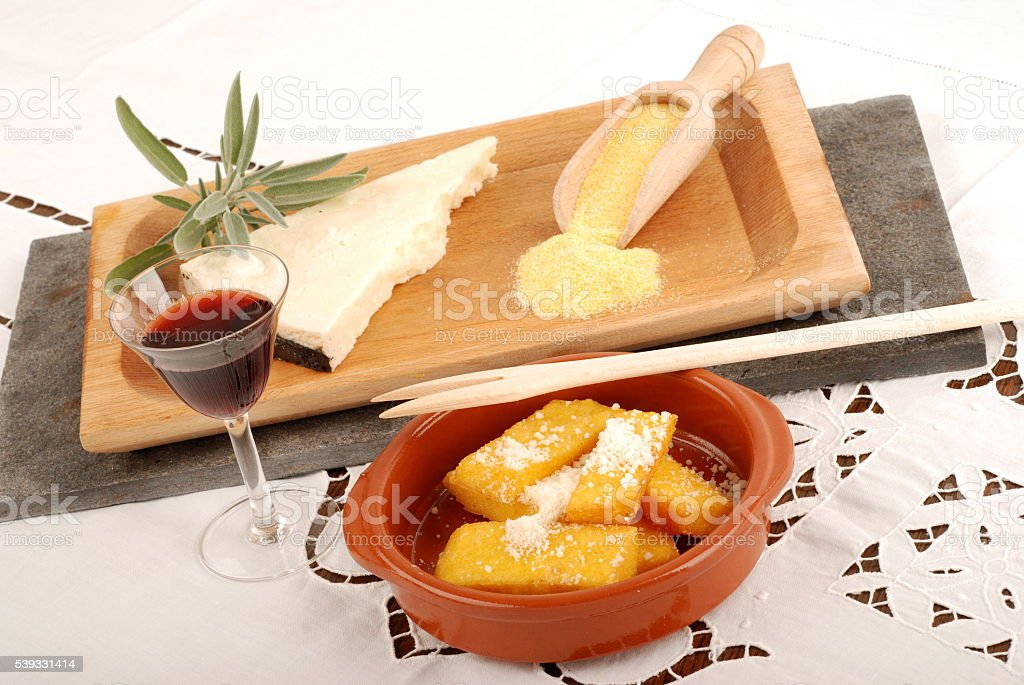 Fried polenta with cheese stock photo