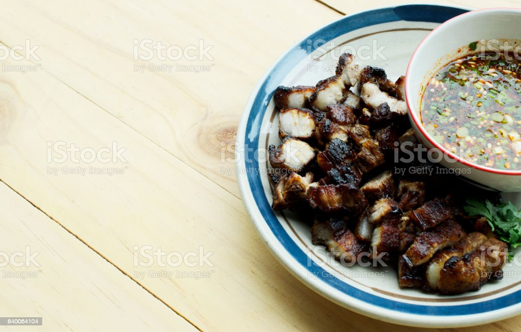 Fried pork belly with fish sauce and Thai Spicy Sauce stock photo