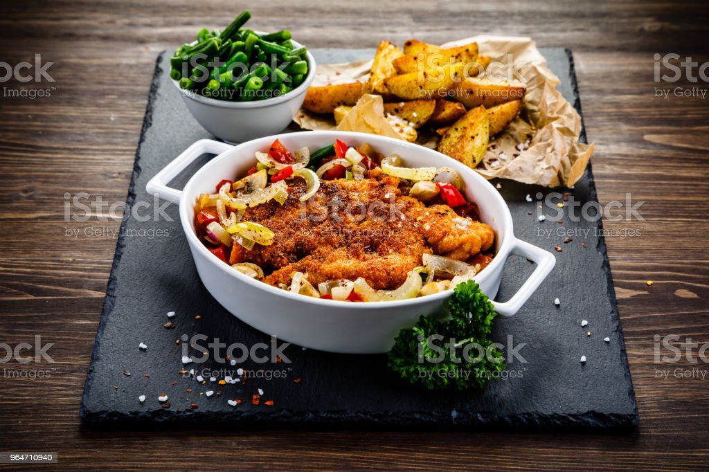 Fried pork chop and vegetables royalty-free stock photo