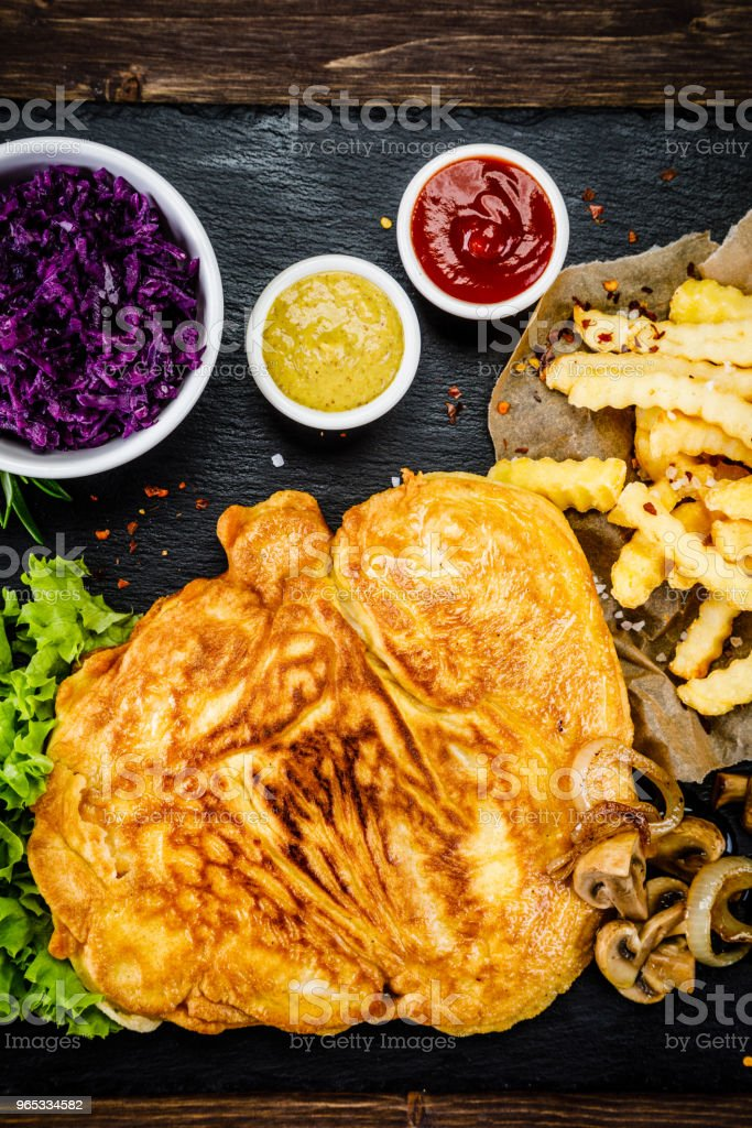 Fried pork chop, French fries and vegetables zbiór zdjęć royalty-free