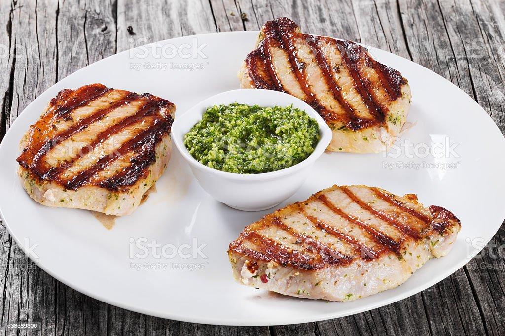 Fried Pork Chops Marinated With Pesto Sauce Stock Photo