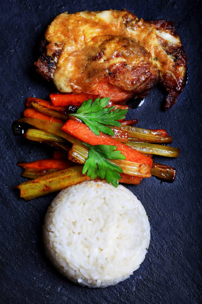 fried pork with rice and vegetables - paprikaschnitzel stock-fotos und bilder
