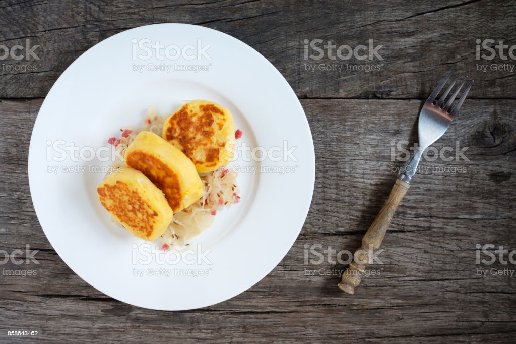 Fried potato pancakes with sauerkraut and bacon stock photo