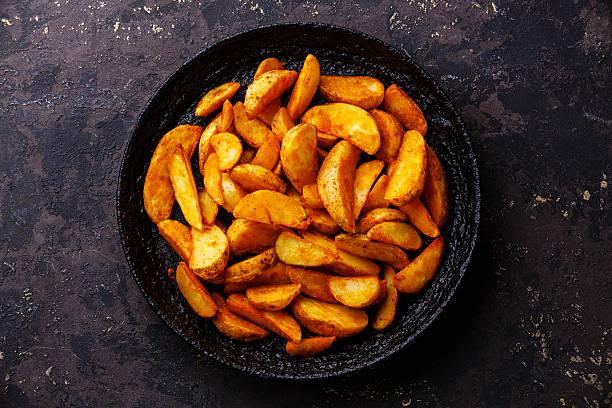 Fried potato wedges stock photo