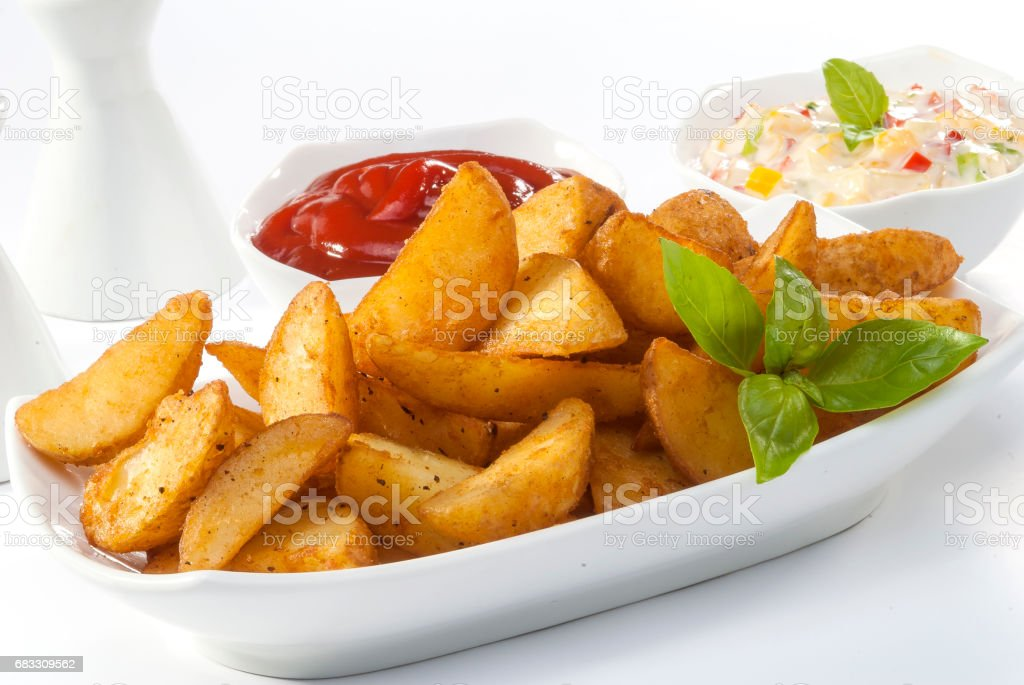 Fried potato wedges with coleslaw & ketchup with basil leaf royalty-free stock photo