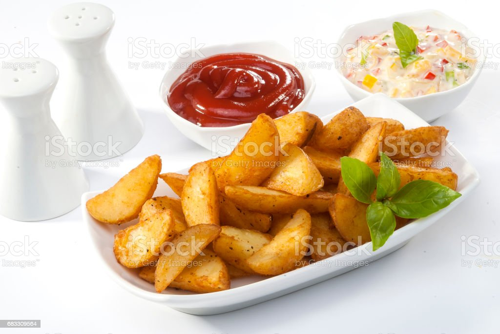 Fried potato wedges with coleslaw & ketchup with basil leaf zbiór zdjęć royalty-free
