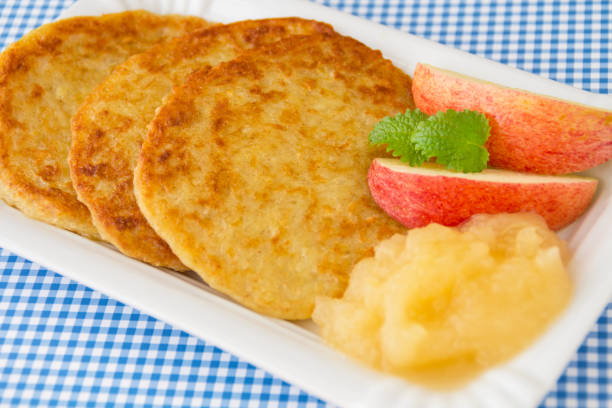 Fried potatoes pancake and apples stock photo