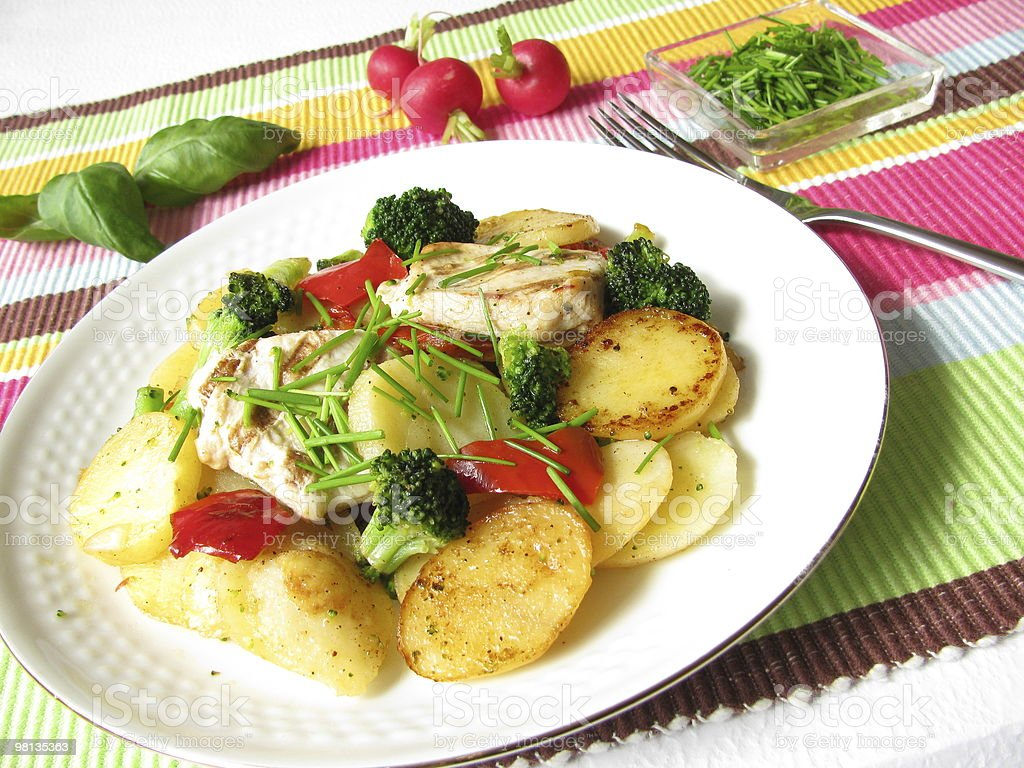 Fried potatoes with colored vegetables royalty-free stock photo