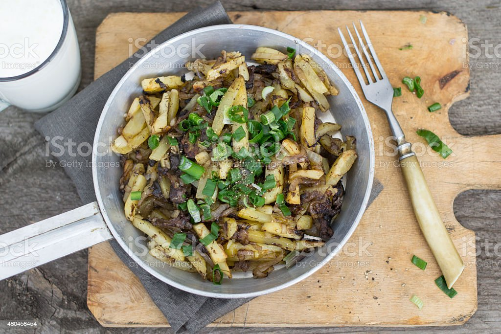 Fried potatoes with mushrooms stock photo