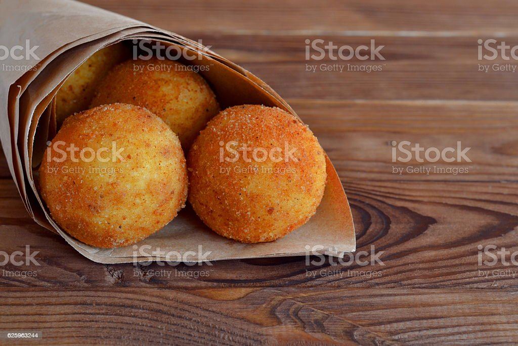 Fried rice balls in paper stock photo