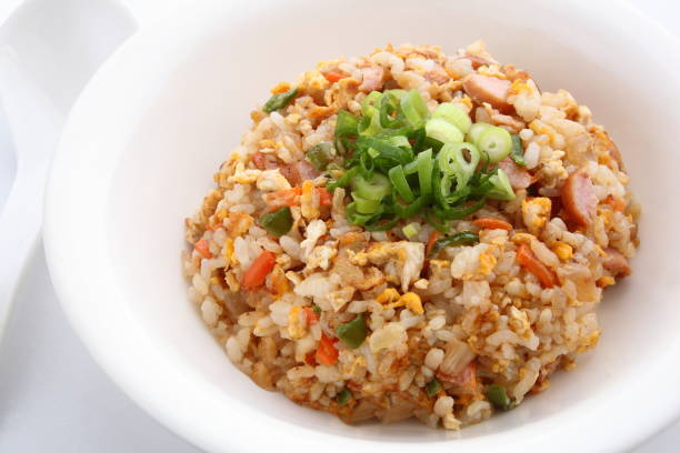 Fried Rice, Chinese Food Fried rice with some ingredients such as eggs, vegetables, and meat. fried rice stock pictures, royalty-free photos & images