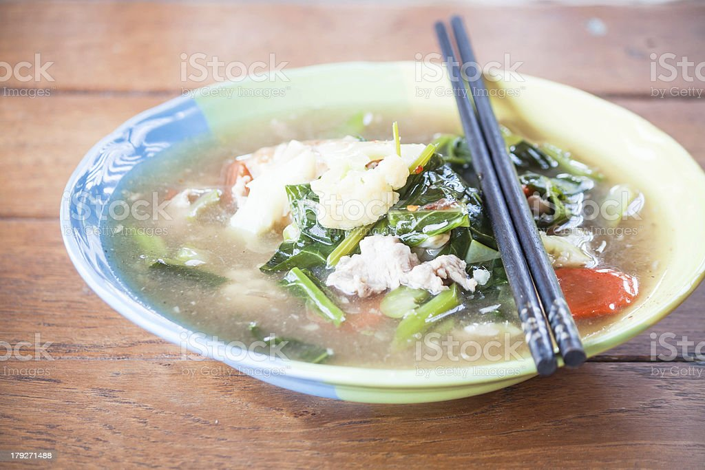 Fried rice noodles topped with pork and wood chopsticks royalty-free stock photo