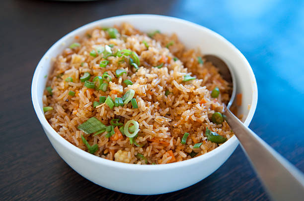 Fried rice A bowl of delicious oriental fried rice fried rice stock pictures, royalty-free photos & images